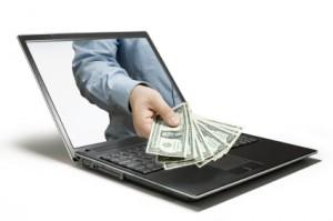 Computer-Hand-w-Money-300x199